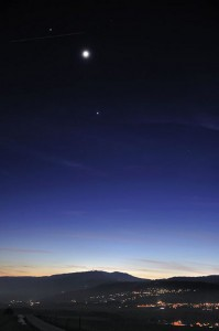 The Moon, Venus and Jupiter, over the Jura Mountains